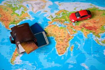 planing a trip toy car on map with wallet