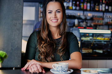 Brunette woman in a cafe.