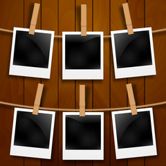 Set of photo frames on the rope with clothespin. Photo frames set on wood