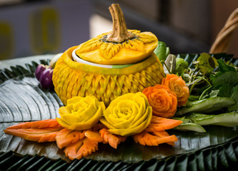 Thai food.Vegetables  are carved (Pumpkin and carrot. Art in food. Thai food decoration.