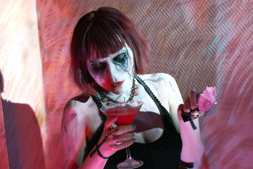 model with gothic makeup bloody cocktail drinks