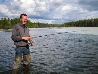 Angler fishing for salmon, Talkeetna River, Alaska