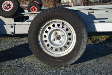 Closeup photo of trailer wheel on road