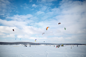 snow kiting on a snowboard on a frozen lake