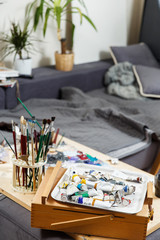 Art studio with brushes ,paints