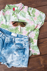 Woman summer clothes on wooden background