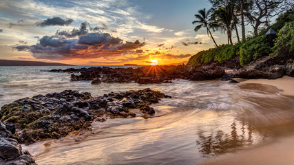 a dramatic sunset on the tropical island of Maui, Hawaii from secret cove Wall mural