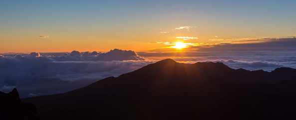 sunrise above the clouds at 10000 feet  from the summit of Haleakala volcano on the tropical hawaiian island of Maui