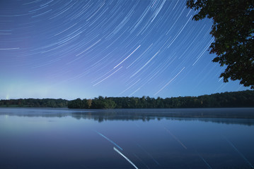 Star Trails and the Northern Lights over a lake