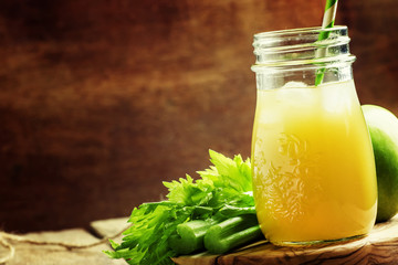Freshly squeezed juice with celery, green apple and ice. Vintage