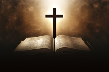 Holy Bible with a cross and a light coming from above
