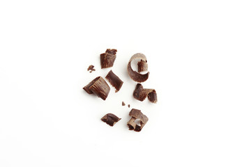 Dark chocolate shavings on white background