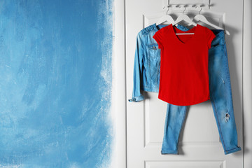 Wall Mural - Female clothes hanging on door