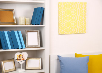 White wooden shelving with books and decoration