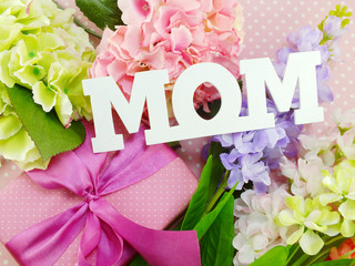 close up of text mom word copy with gift and fllower