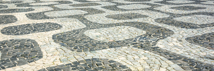 Black and white iconic mosaic, Portuguese pavement by old design pattern at Ipanema beach, Rio de Janeiro, Brazil