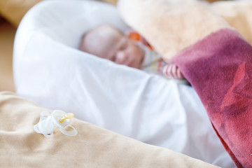 Portrait of cute adorable newborn baby girl sleeping