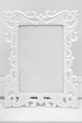 white patterned photo frame on the table