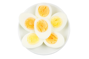 Half of boiled eggs in glass plate isolated on white