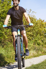Cycling man in countryside