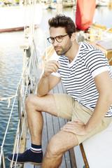 Dude on boat in harbor, looking away
