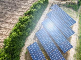 Solar panels (solar cell) in solar farm with  lighting.