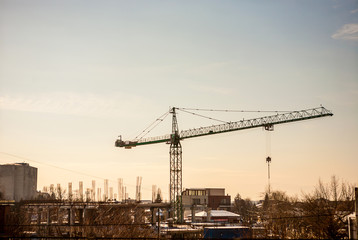 Construction with a crane in industrializes area