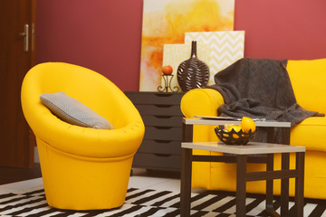 Modern living room interior with yellow sofa