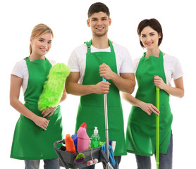 Service team with cleaning equipment on white background