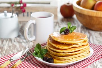 Homemade pancakes with honey and berry fruit. Closeup, selective focus.