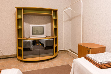 The interior of the small room, the view on the shelf with a TV