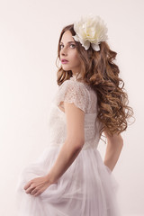 girl in white dress and with white flower in her hair