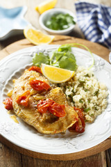 Trout, cooked with smoked paprika, tomatoes and couscous