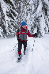 Traveler goes in snowshoes - adventure in the wild