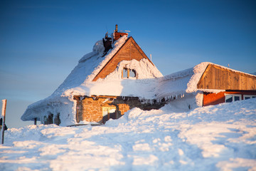 Wooden houses in snowy scenery
