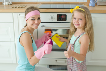 Woman and child cleans the house
