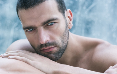 Sexy close-up portrait of handsome topless male model. Beautiful eyes.