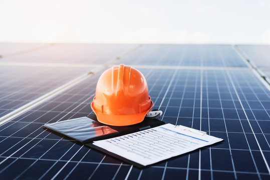 Orange helmet and documents On solar cells