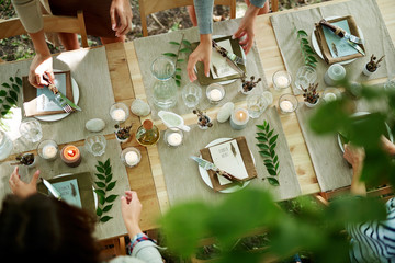 Top-view of served table with burning candles