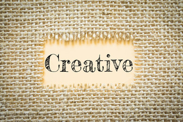 Text Creative on paper Orange has Cotton yarn background you can apply to your product.