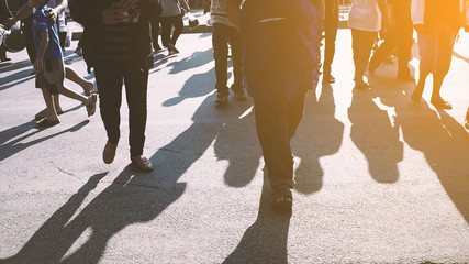 People walking on the pedestrian crossing.