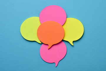 sticky notes in the shape of speech balloons