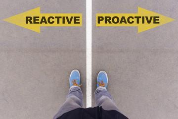 Reactive vs proactive text arrows on asphalt ground, feet and sh