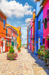 Multicolor houses with fantastic sky in background