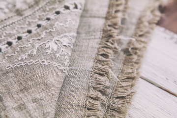 Embroidery background. Linen with needlework in progress. Coloring and processing photos. Shallow depth of field.
