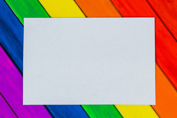 Trims in rainbow colors. Colorful wooden background. gay flag.
