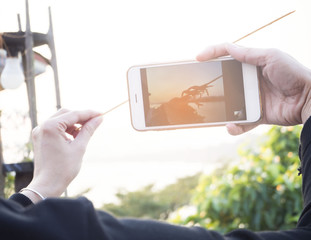 Girl using smartphone taking photo, vacation concept
