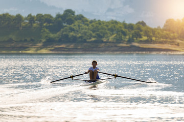 single rower at sunrise