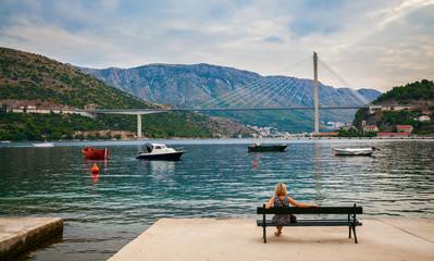 woman looking at the Tudjman Bridge in Dubrovnik