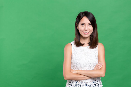 Young asian woman over green background